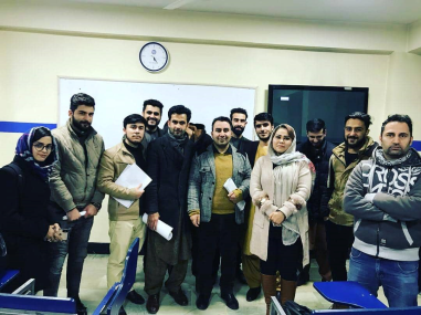 With his class on his last day of teaching.